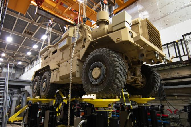 A military vehicle positioned atop test equipment