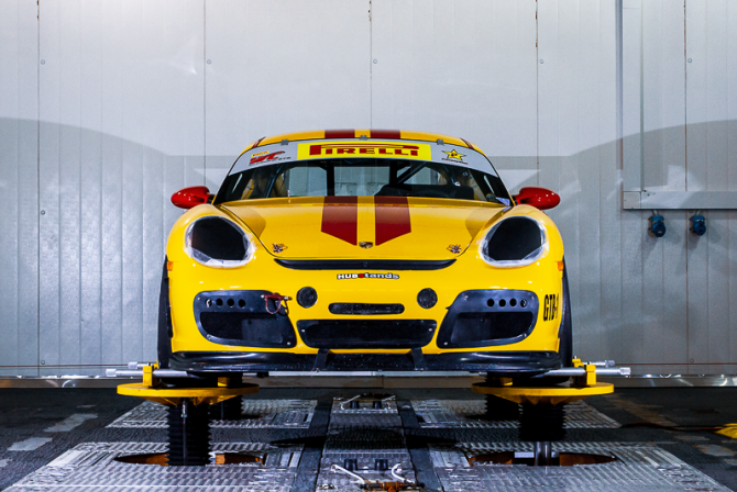 Yellow sports car perched on a platform