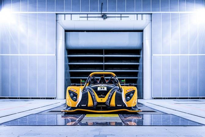Yellow race car in a test chamber