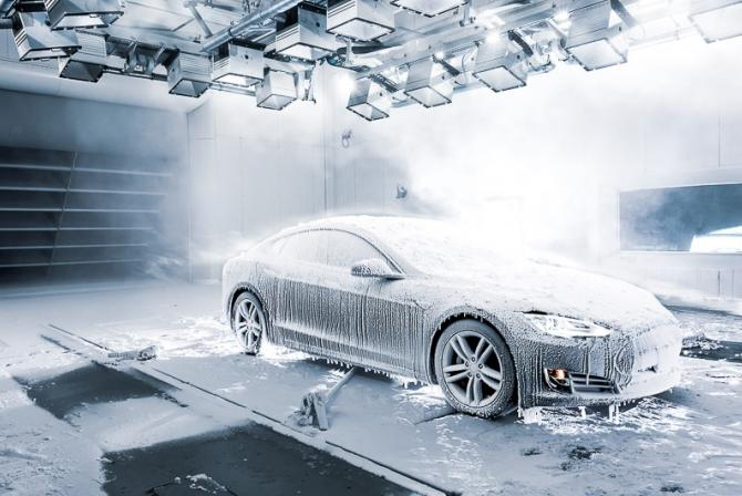 Car covered in ice and snow in a test chamber