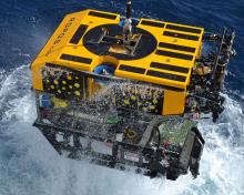 Remotely operated vehicle being pulled out of the ocean